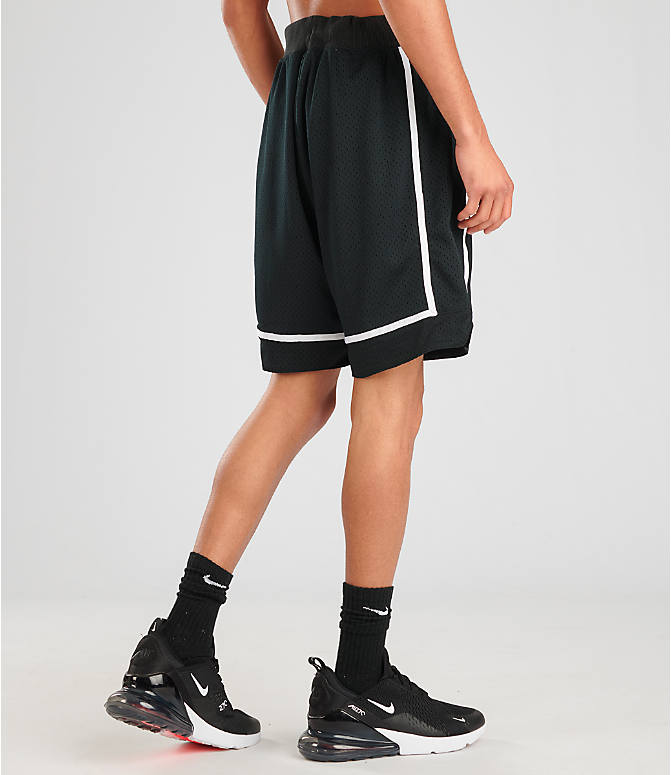 Back Right view of Men's Nike Sportswear Statement Mesh Shorts in Black/White