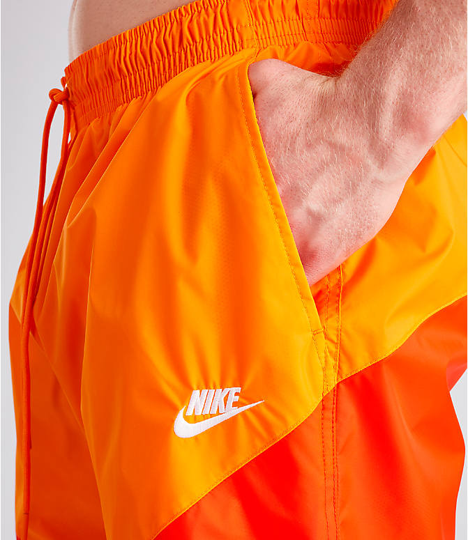 Detail 1 view of Men's Nike Sportswear Windrunner Shorts in Orange Peel
