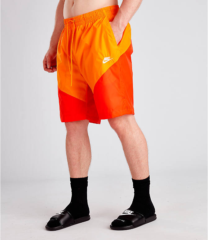 Front view of Men's Nike Sportswear Windrunner Shorts in Orange Peel