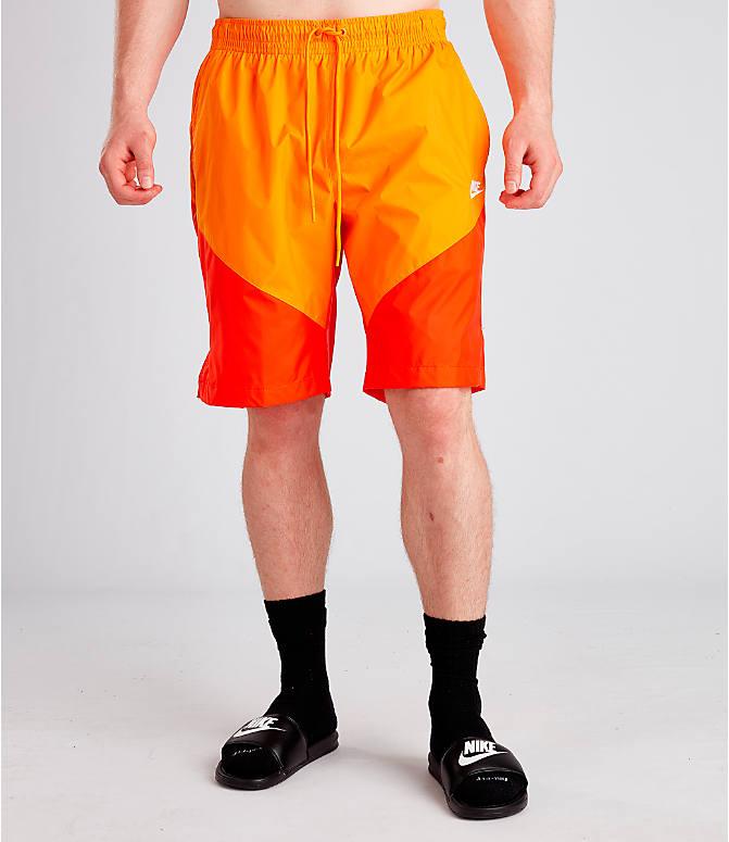 Front Three Quarter view of Men's Nike Sportswear Windrunner Shorts in Orange Peel