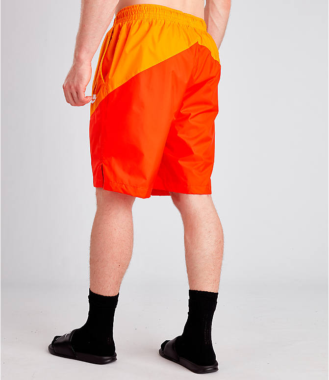 Back Left view of Men's Nike Sportswear Windrunner Shorts in Orange Peel