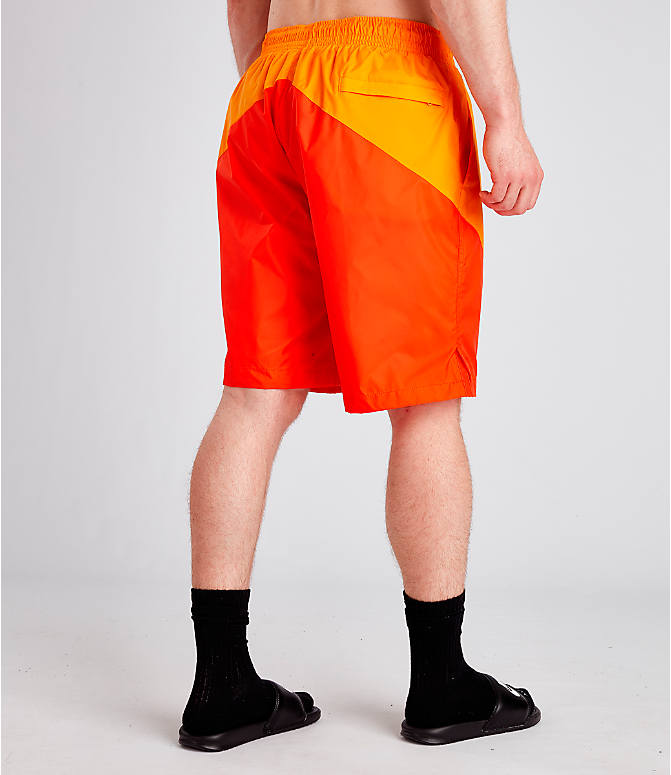 Back Right view of Men's Nike Sportswear Windrunner Shorts in Orange Peel