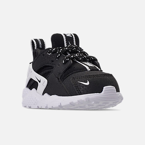 Three Quarter view of Boys' Toddler Nike Huarache Run SE Casual Shoes in Black/Black/White