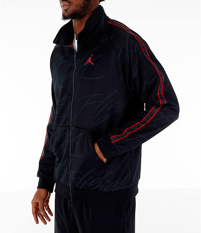 Front view of Men's Jordan Jumpman Graphic Track Jacket in Black/Gym Red