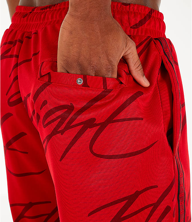 Detail 2 view of Men's Jordan Jumpman Graphic Track Pants in Gym Red/Black