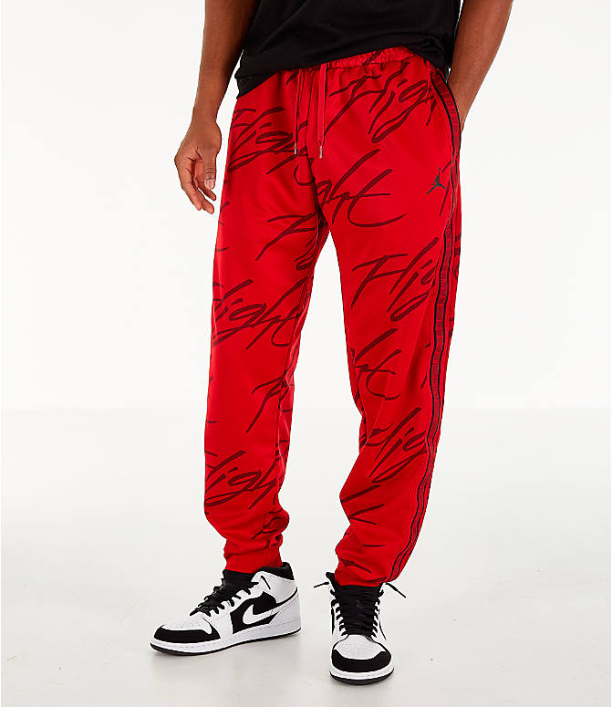 Front view of Men's Jordan Jumpman Graphic Track Pants in Gym Red/Black