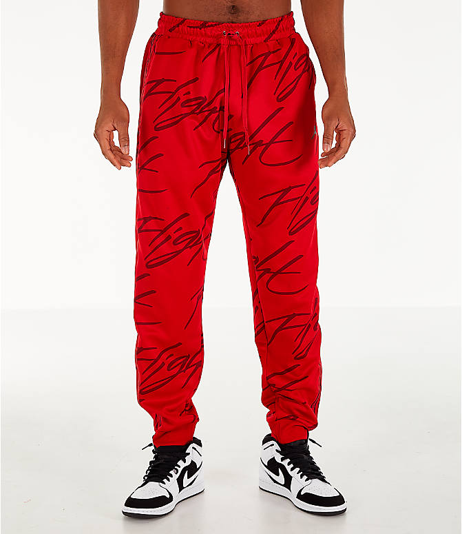 Front Three Quarter view of Men's Jordan Jumpman Graphic Track Pants in Gym Red/Black