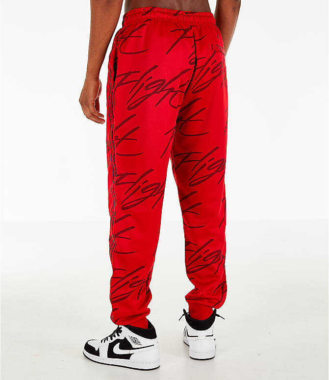 Back Left view of Men's Jordan Jumpman Graphic Track Pants in Gym Red/Black