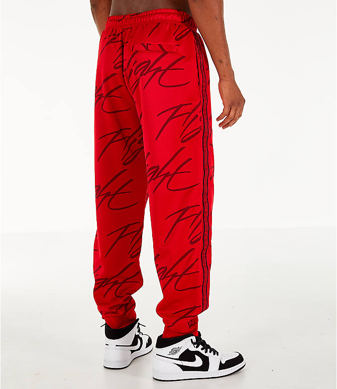 Back Right view of Men's Jordan Jumpman Graphic Track Pants in Gym Red/Black