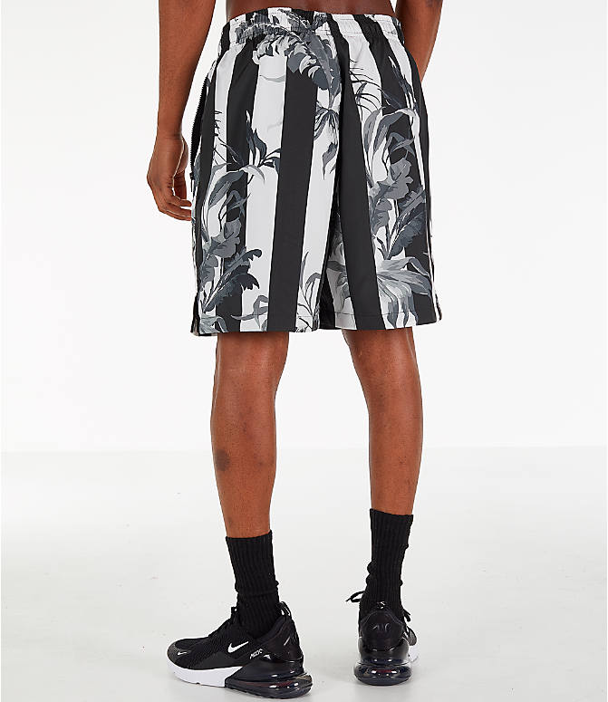 Back Left view of Men's Nike Sportswear Floral Soccer Shorts in Black/White