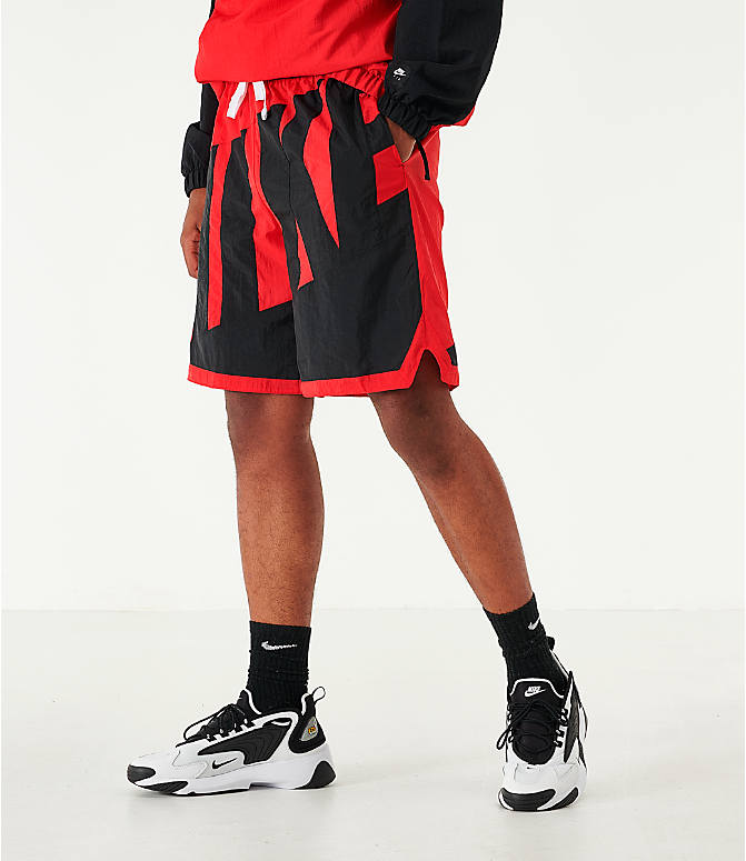 Back Left view of Men's Nike Dri-FIT Throwback Basketball Shorts in Red/Black