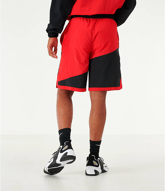 Back Right view of Men's Nike Dri-FIT Throwback Basketball Shorts in Red/Black