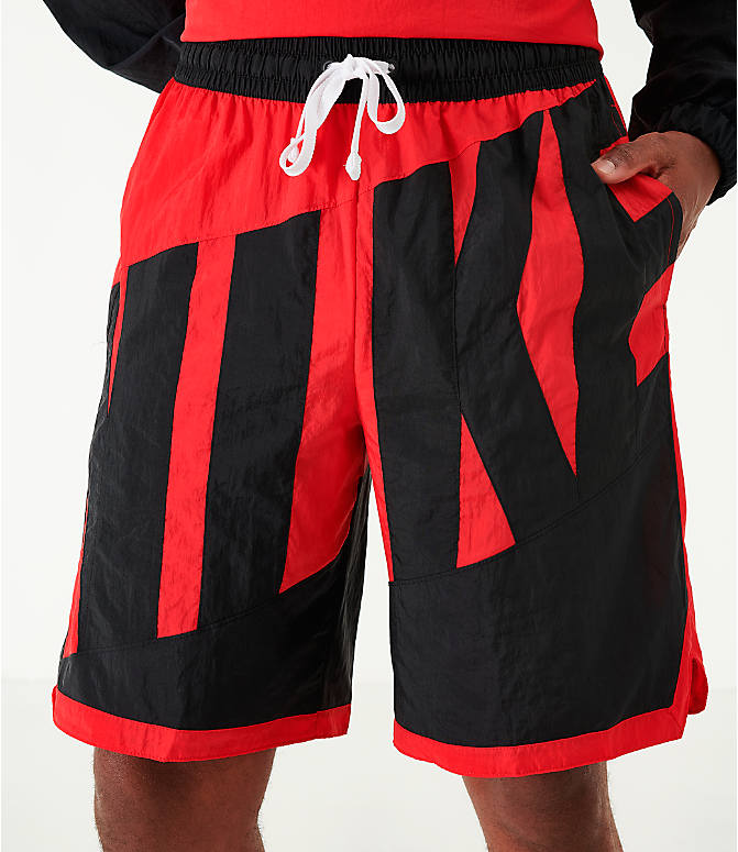 On Model 5 view of Men's Nike Dri-FIT Throwback Basketball Shorts in Red/Black