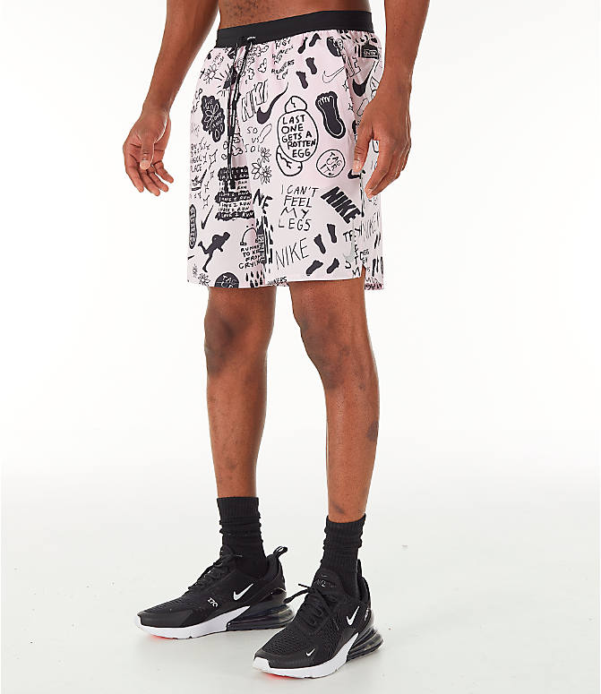 Front Three Quarter view of Men's Nike Flex Stride Nathan Bell 7 Inch Printed Running Shorts in Pink Foam