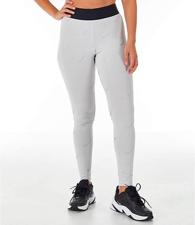 Front view of Women's Nike Sportswear Metallic Clash Leg-A-See Allover Print Leggings in Grey/Metal