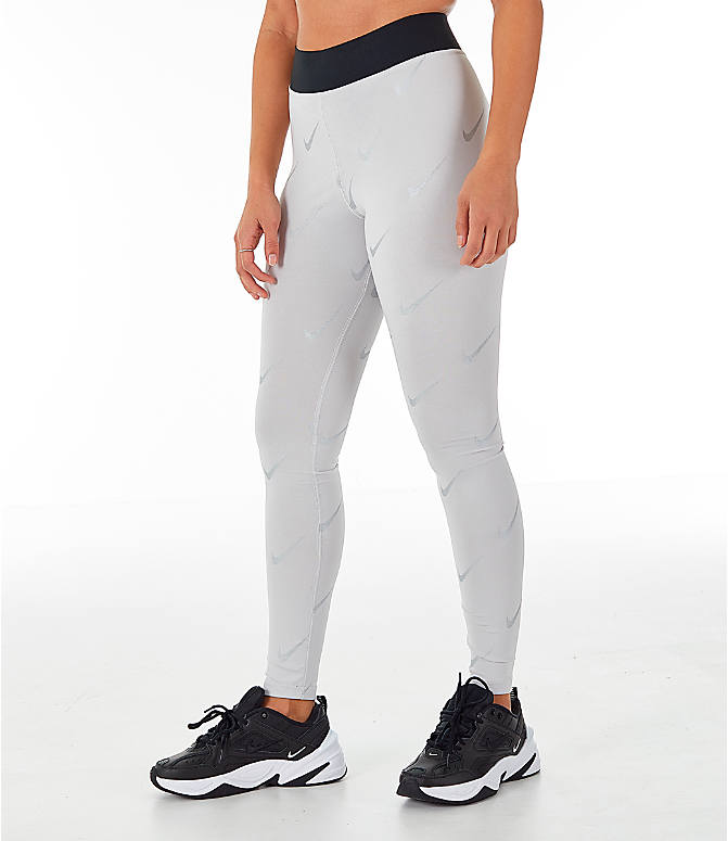 Front Three Quarter view of Women's Nike Sportswear Metallic Clash Leg-A-See Allover Print Leggings in Grey/Metal