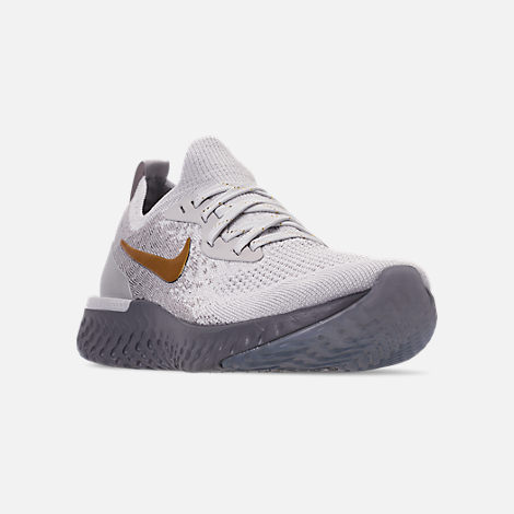 Three Quarter view of Women's Nike Epic React Flyknit Running Shoes in Vast Grey/Metallic Gold/Metallic Platinum