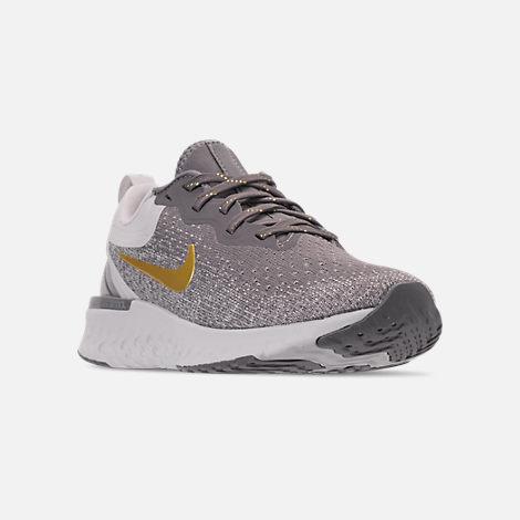 wholesale dealer ebeaa fa475 Three Quarter view of Women s Nike Odyssey React Metallic Premium Running  Shoes in Gunsmoke Metallic