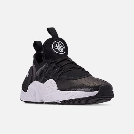 6f7809a5306 Three Quarter view of Men s Nike Huarache E.D.G.E. Leather Running Shoes in  Black White