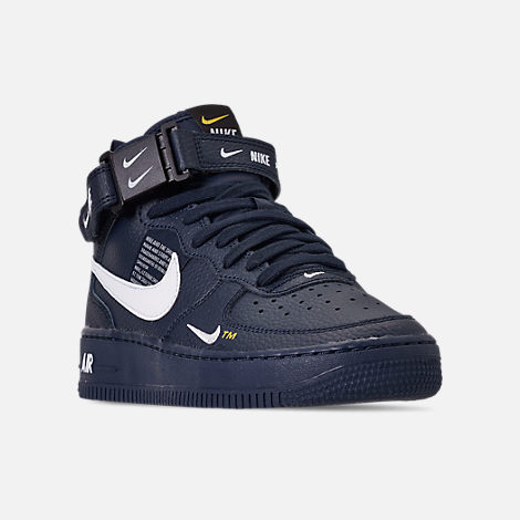 Three Quarter view of Boys' Big Kids' Nike Air Force 1 Mid LV8 Leather Casual Shoes in Obsidian/White/Black/Tour Yellow
