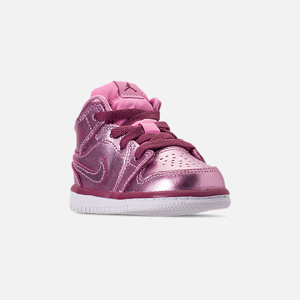 Three Quarter view of Girls' Toddler Air Jordan 1 Mid Casual Shoes in Pink Rise/White/Noble Red
