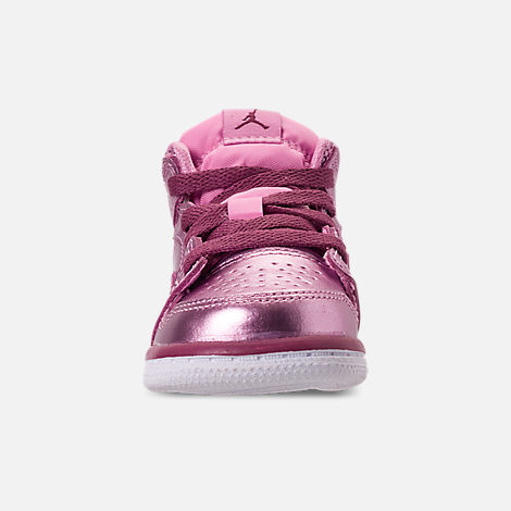 Front view of Girls' Toddler Air Jordan 1 Mid Casual Shoes in Pink Rise/White/Noble Red