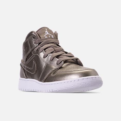 5979a5226063e1 Three Quarter view of Girls  Big Kids  Air Jordan 1 Mid SE Casual Shoes