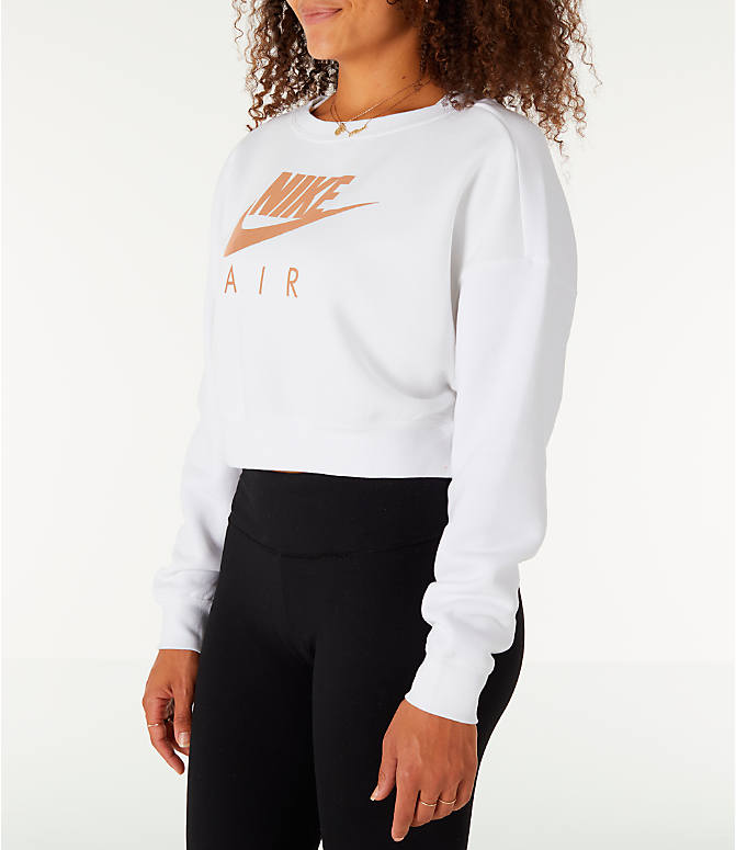 Front Three Quarter view of Women's Nike Sportswear Rally Crew Sweatshirt in White/Rose Gold