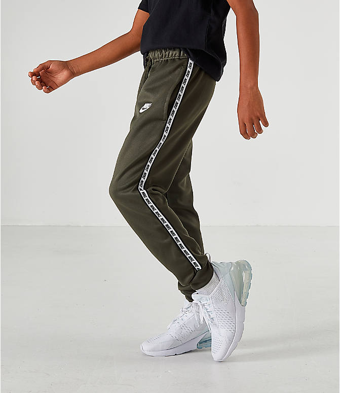 finest selection 79e55 ae7c0 Front view of Boys  Nike Taped Jogger Pants in Green