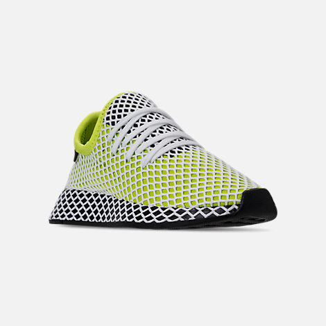 Three Quarter view of Kids' Grade School adidas Originals Deerupt Runner Casual Shoes in Semi Solar Slime/Core Black