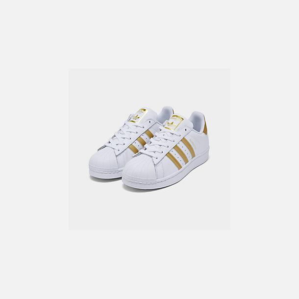 Three Quarter view of Big Kids' adidas Superstar Casual Shoes in White/Metallic Gold