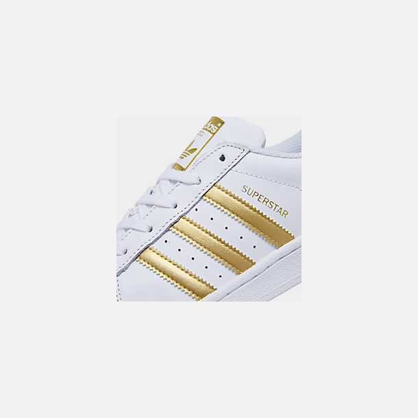 Front view of Big Kids' adidas Superstar Casual Shoes in White/Metallic Gold