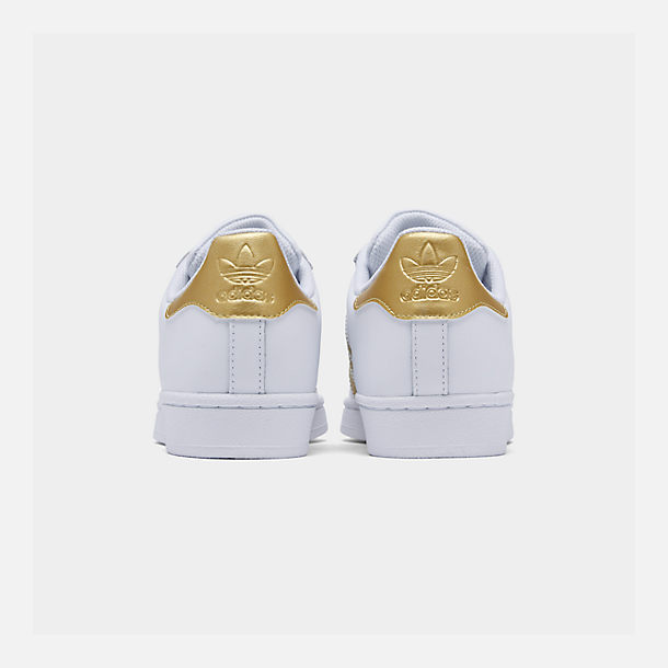 Left view of Big Kids' adidas Superstar Casual Shoes in White/Metallic Gold