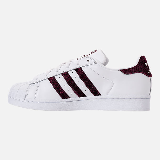 Left view of Women's adidas Originals Superstar Leather Casual Shoes in Footwear White/Red Night/Silver Metallic
