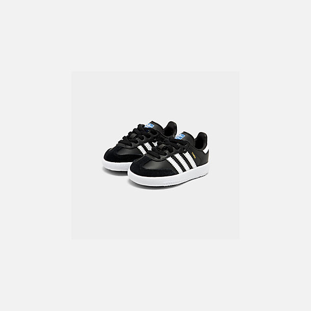 Three Quarter view of Boys' Toddler adidas Originals Samba Casual Shoes in Black/White
