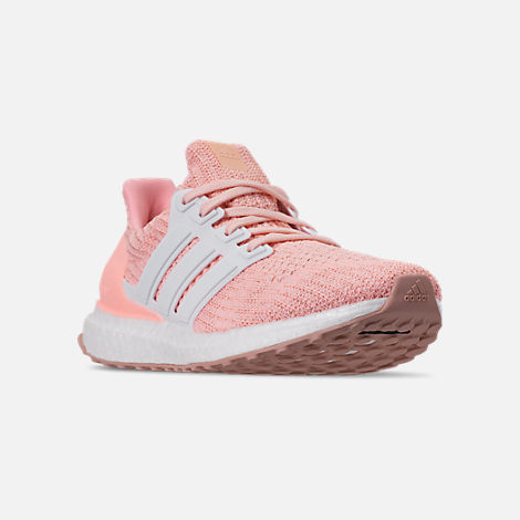Three Quarter view of Girls' Big Kids' adidas UltraBOOST Running Shoes in Clear Orange/Cloud White
