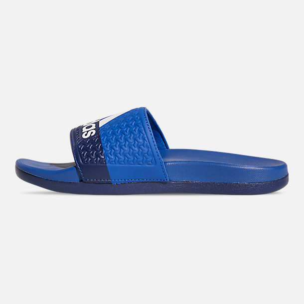 Left view of Big Kids' adidas Adilette Comfort Slide Sandals in Collegiate Royal/Cloud White/Blue