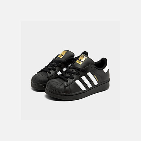 Three Quarter view of Little Kids' adidas Superstar Casual Shoes in Black/White