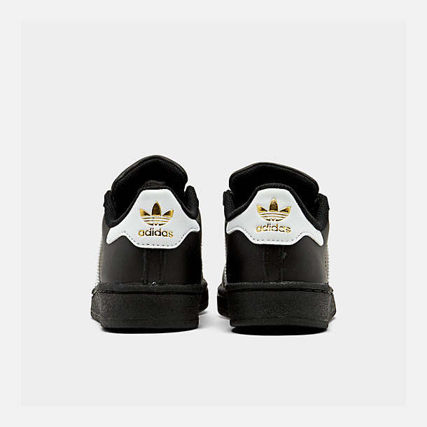 Left view of Little Kids' adidas Superstar Casual Shoes in Black/White