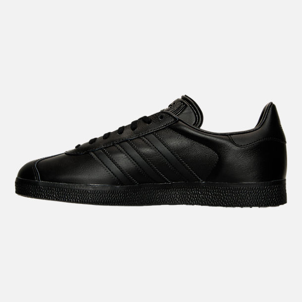 Left view of Men's adidas Gazelle Leather Casual Shoes in Core Black/Metallic Gold