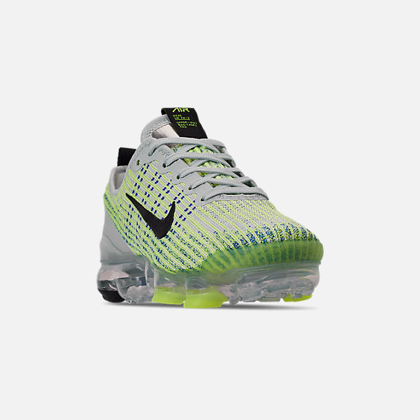 Three Quarter view of Big Kids' Nike Air VaporMax Flyknit 3 Running Shoes in Light Silver/Black/Volt Glow/Game R