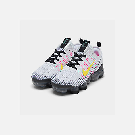 Three Quarter view of Big Kids' Nike Air VaporMax Flyknit 3 Running Shoes in White/Dynamic Yellow/Hyper Turquoise