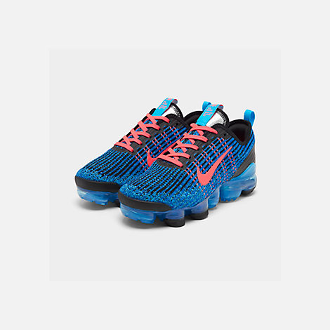 Three Quarter view of Big Kids' Nike Air VaporMax Flyknit 3 Running Shoes in Blue Fury/Flash Crimson/Racer Blue