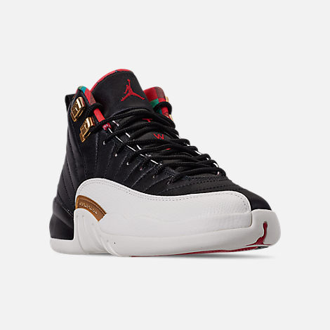 Three Quarter view of Big Kids' Air Jordan Retro 12 Chinese New Year Basketball Shoes in Black/Sail/Metallic Gold/Chinese Red
