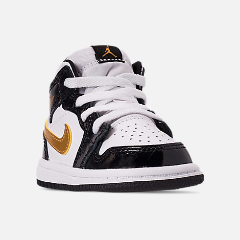 Three Quarter view of Boys' Toddler Air Jordan 1 Mid SE Casual Shoes in Black/Metallic Gold/White