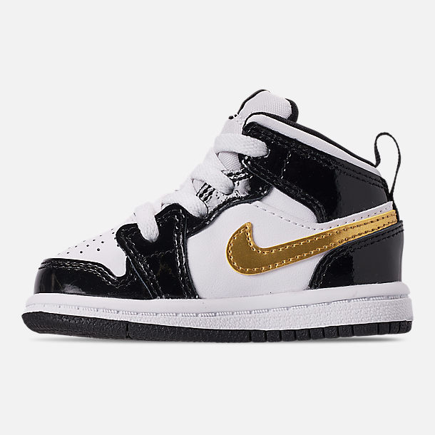 Left view of Boys' Toddler Air Jordan 1 Mid SE Casual Shoes in Black/Metallic Gold/White