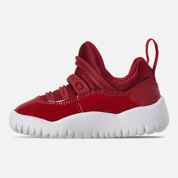 Left view of Boys' Toddler Air Jordan Retro 11 Little Flex Basketball Shoes in Gym Red/Black/White