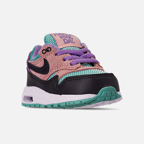 Three Quarter view of Kids' Toddler Nike Air Max 1 Casual Shoes in Black/White/Space Purple/Bleached Coral