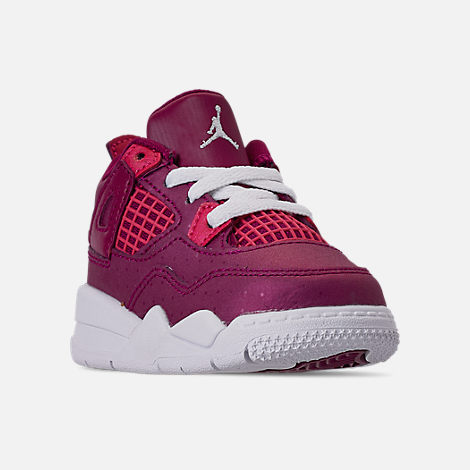 Three Quarter view of Girls' Toddler Air Jordan Retro 4 Basketball Shoes in True Berry/Rush Pink/White