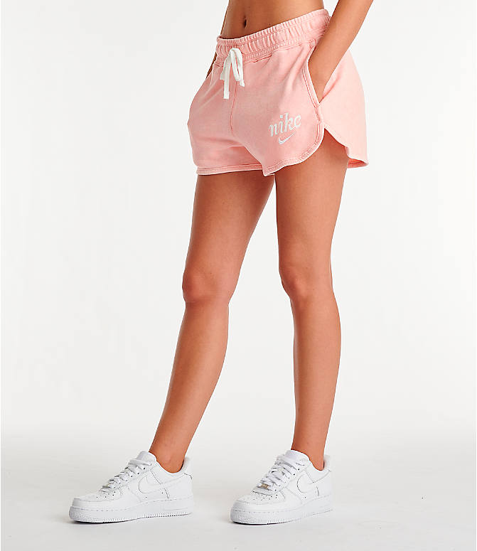 Front Three Quarter view of Women's Nike Sportswear Shorts in Bleached Coral/Summit White
